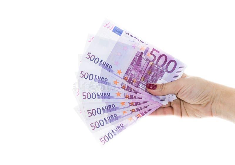 Χέρι που κρατά τα ευρο- χρήματα 500 απομονωμένα στο άσπρο υπόβαθρο στοκ εικόνα με δικαίωμα ελεύθερης χρήσης