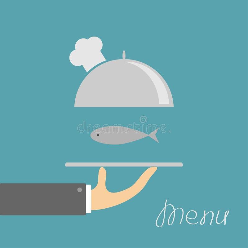 Χέρι που κρατά την ασημένια πιατέλα cloche με το καπέλο και τα ψάρια αρχιμαγείρων Κάρτα επιλογών πρόσκληση συγχαρητηρίων καρτών α απεικόνιση αποθεμάτων