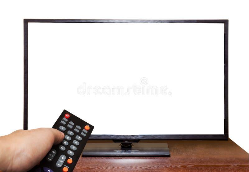 Χέρι που κρατά τον τηλεχειρισμό στην οθόνη TV που απομονώνεται στο άσπρο υπόβαθρο στοκ εικόνα