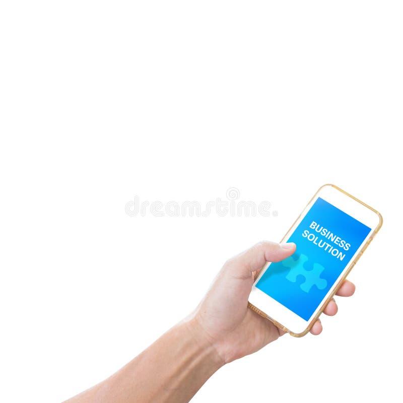 Χέρι που κρατά το κινητό τηλέφωνο με τη λέξη επιχειρησιακής λύσης στοκ εικόνες με δικαίωμα ελεύθερης χρήσης