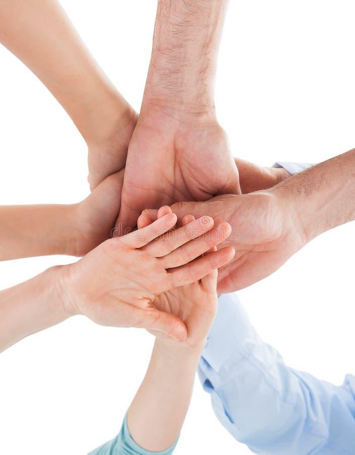 Χέρι που συσσωρεύεται πέρα από μεταξύ τους στοκ φωτογραφία με δικαίωμα ελεύθερης χρήσης