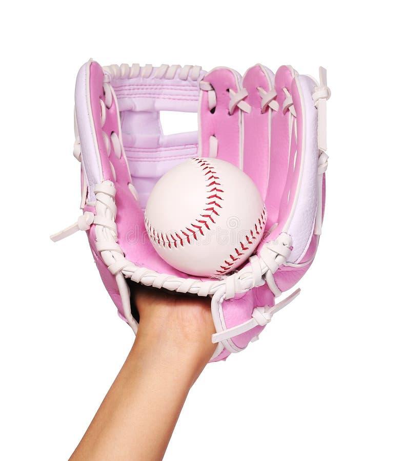 Χέρι του παίχτη του μπέιζμπολ με το ρόδινο γάντι και της σφαίρας που απομονώνεται στοκ φωτογραφία με δικαίωμα ελεύθερης χρήσης