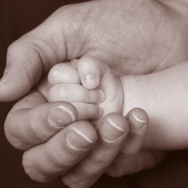 χέρι 3 μωρών στοκ φωτογραφίες