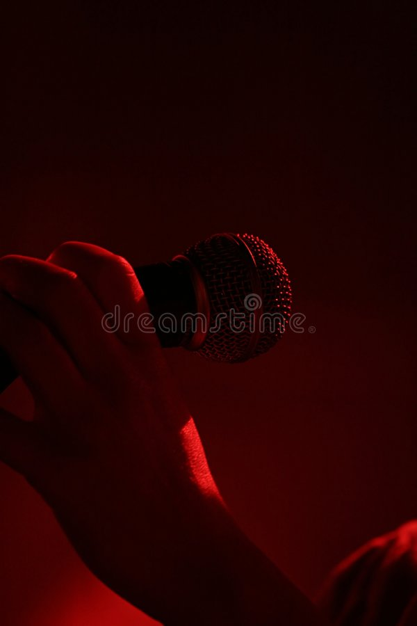 χέρι mic συναυλίας στοκ εικόνες με δικαίωμα ελεύθερης χρήσης