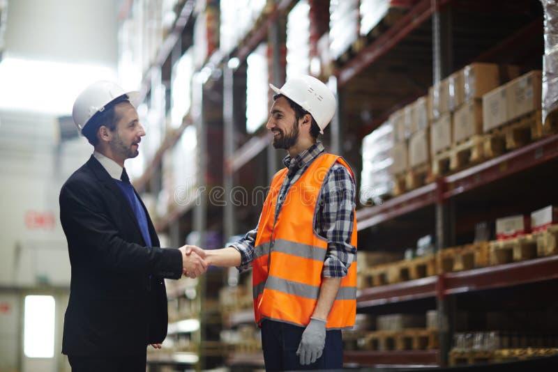 Χαιρετισμός των εργαζομένων στοκ φωτογραφία με δικαίωμα ελεύθερης χρήσης
