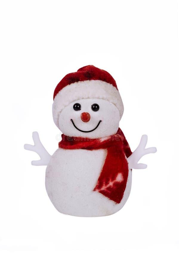 Χαμογελώντας το παιχνίδι χιονανθρώπων που ντύνονται στο μαντίλι και την ΚΑΠ που απομονώνεται στο άσπρο υπόβαθρο στοκ φωτογραφίες με δικαίωμα ελεύθερης χρήσης