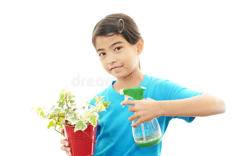 Χαμογελώντας ασιατικό κορίτσι στοκ φωτογραφίες