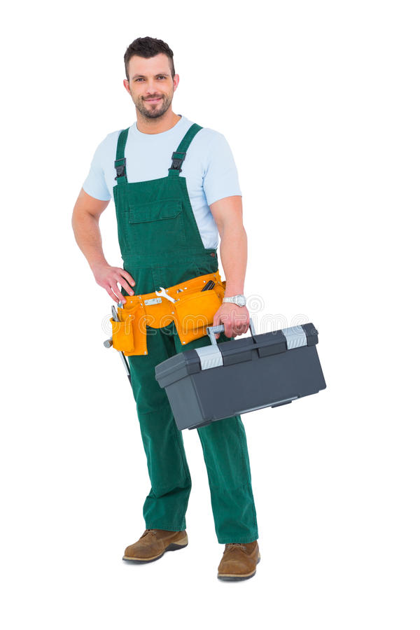 Χαμογελώντας ξυλουργός με την εργαλειοθήκη στοκ εικόνες με δικαίωμα ελεύθερης χρήσης