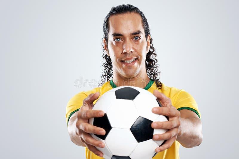 Χαμογελώντας ποδοσφαιριστής στοκ εικόνα