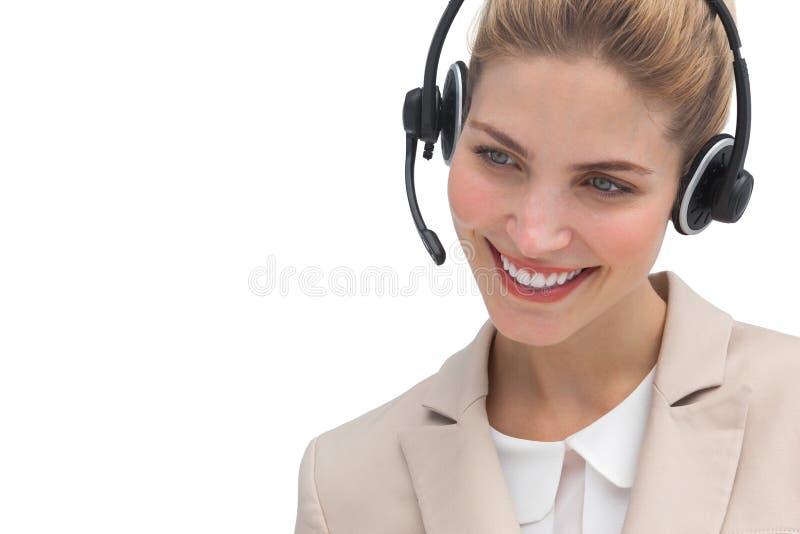 Χαμογελώντας χειριστής τηλεφωνικών κέντρων στοκ φωτογραφίες