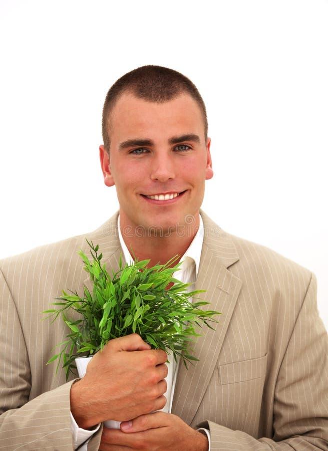 χαμόγελο φυτών επιχειρημ& στοκ εικόνα με δικαίωμα ελεύθερης χρήσης