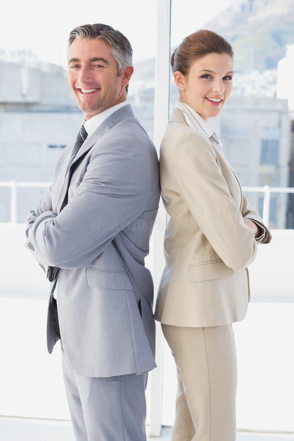 Χαμόγελο επιχειρησιακών ανδρών και γυναικών στοκ εικόνες