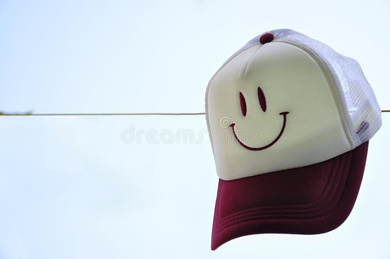 χαμόγελο καπέλων στοκ εικόνες