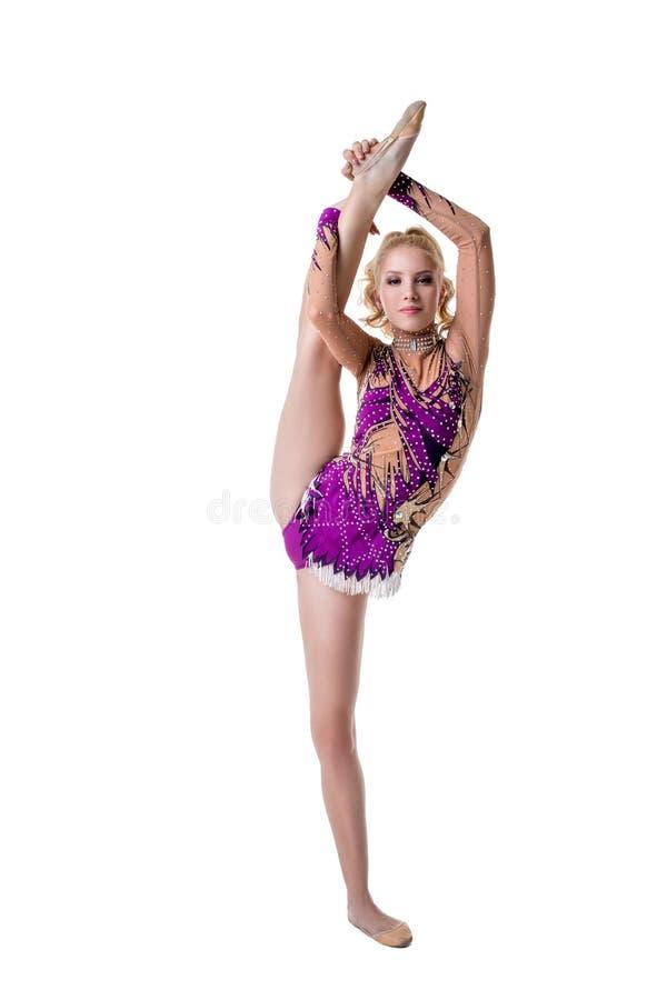 Χαριτωμένη θηλυκή gymnast τοποθέτηση στην κάθετη διάσπαση στοκ εικόνες