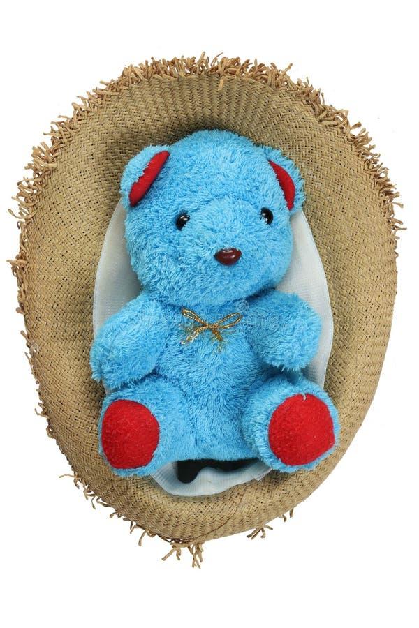 Χαριτωμένη teddy γυμνή κούκλα, στο καπέλο αχύρου που απομονώνεται στο άσπρο υπόβαθρο στοκ εικόνες