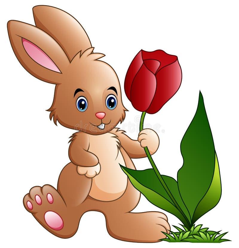 Χαριτωμένος λίγα κινούμενα σχέδια λαγουδάκι που κρατούν ένα λουλούδι ελεύθερη απεικόνιση δικαιώματος