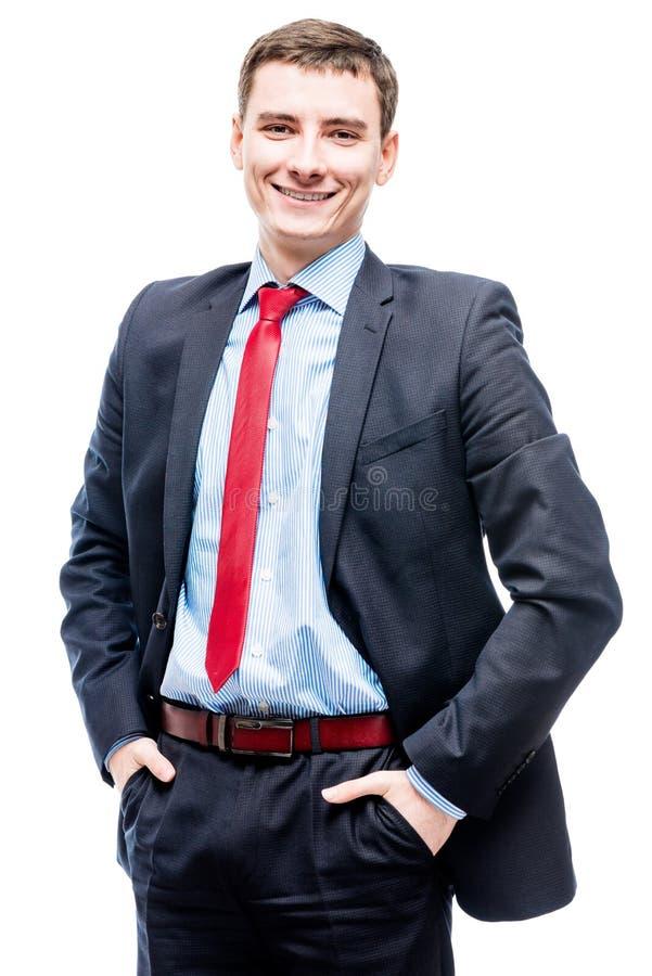 Χαριτωμένος νέος επιτυχής επιχειρηματίας σε ένα άσπρο υπόβαθρο στοκ φωτογραφία