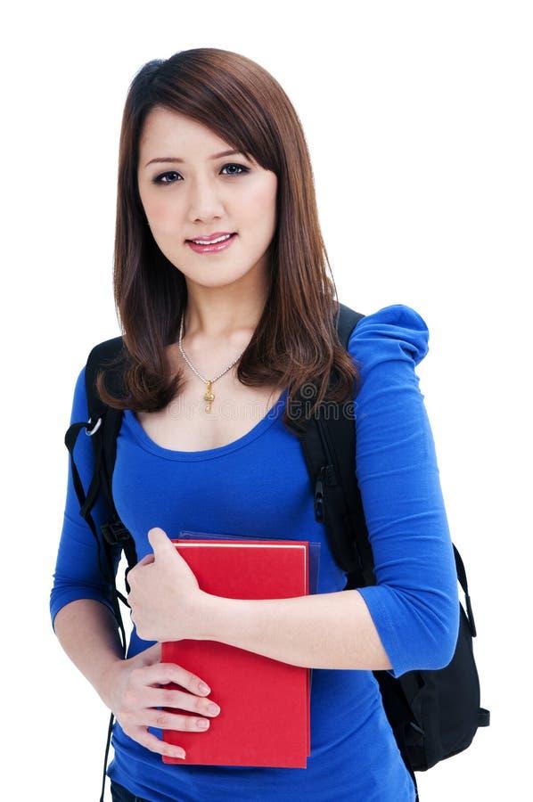 Χαριτωμένος σπουδαστής που κρατά τα βιβλία της στοκ εικόνες