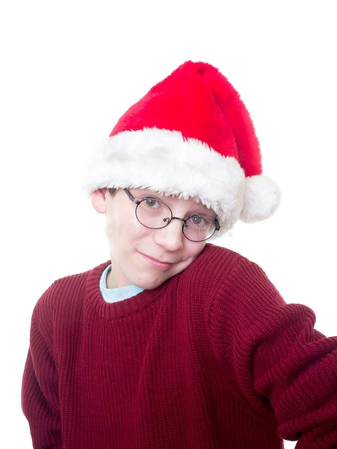 Χαριτωμένο αγόρι στο καπέλο Santa στοκ φωτογραφία