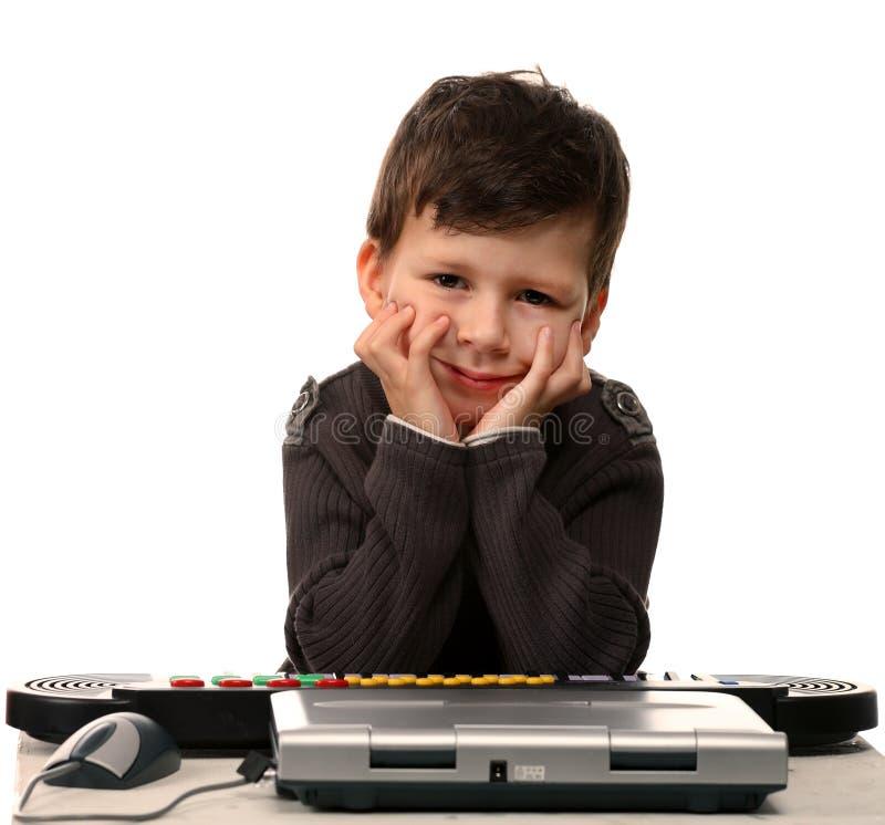 χαριτωμένο ηλεκτρικό πιάνο lap-top παιδιών στοκ εικόνα