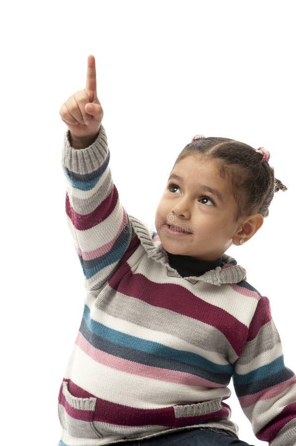 χαριτωμένο κορίτσι λίγα που δείχνουν πρός τα πάνω στοκ φωτογραφία με δικαίωμα ελεύθερης χρήσης
