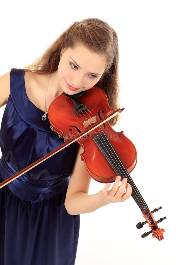 Χαριτωμένο κορίτσι με το βιολί σε ένα λευκό στοκ εικόνες