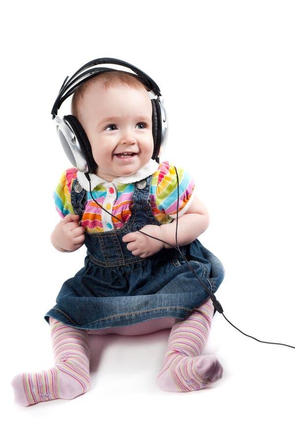 χαριτωμένο κορίτσι μωρών λί&gam στοκ εικόνα με δικαίωμα ελεύθερης χρήσης