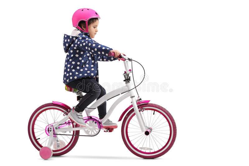 χαριτωμένο κορίτσι ποδηλά& στοκ εικόνες