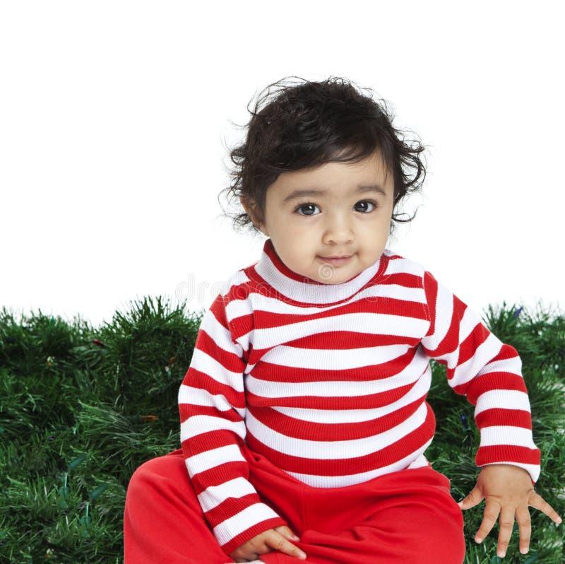 Download Χαριτωμένο κοριτσάκι μπροστά από μια ανασκόπηση Χριστουγέννων Στοκ Εικόνες - εικόνα από οδηγημένος, αρκετά: 17058274
