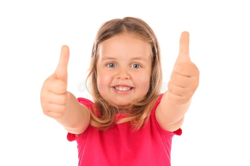 Χαριτωμένο μικρό κορίτσι που παρουσιάζει χειρονομία αντίχειρας-UPS στο άσπρο υπόβαθρο στοκ φωτογραφία με δικαίωμα ελεύθερης χρήσης