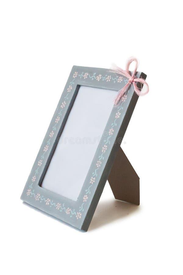 Χαριτωμένο μπλε ξύλινο πλαίσιο, τόξο που απομονώνεται στοκ φωτογραφία με δικαίωμα ελεύθερης χρήσης