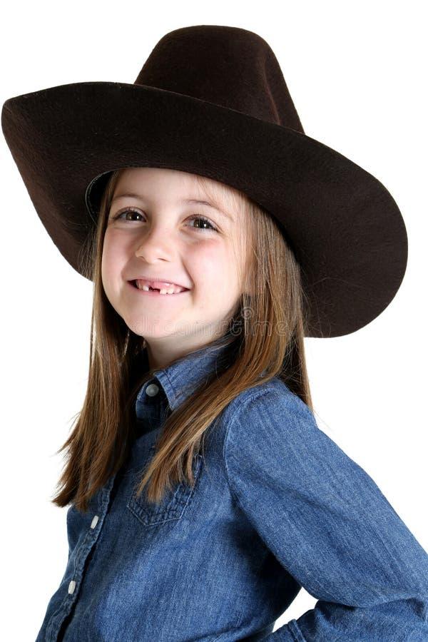 Χαριτωμένο νέο cowgirl που χάνει το μπροστινό χαμόγελο δοντιών της στοκ εικόνα με δικαίωμα ελεύθερης χρήσης