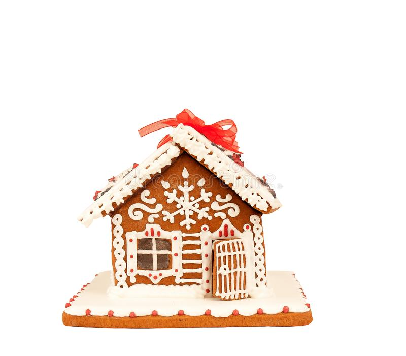 Χαριτωμένο σπίτι μελοψωμάτων που απομονώνεται στο άσπρο υπόβαθρο στοκ εικόνες