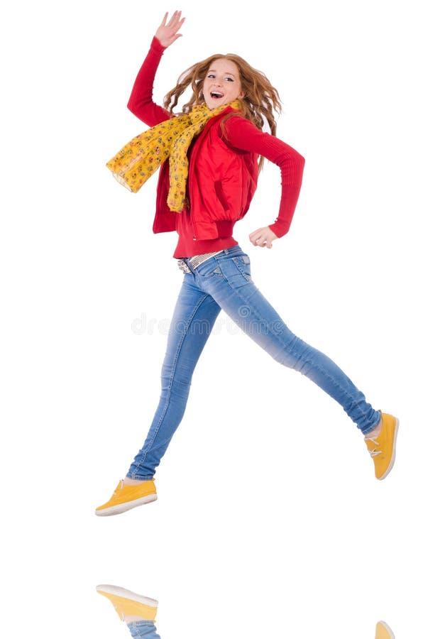 Χαριτωμένο χαμογελώντας κορίτσι σακάκι και τζιν που απομονώνονται στο κόκκινο στοκ εικόνες με δικαίωμα ελεύθερης χρήσης