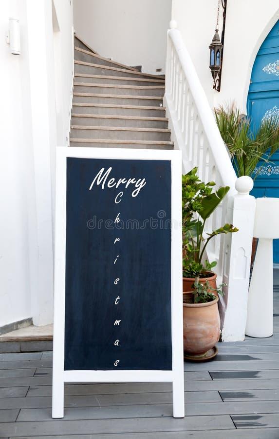 Χαρούμενα Χριστούγεννα διαφήμισης πινάκων στοκ φωτογραφία με δικαίωμα ελεύθερης χρήσης