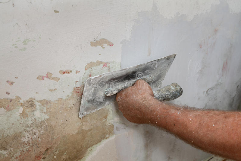 Χαλασμένος αποτύπωση τοίχος εργαζομένων στοκ εικόνες