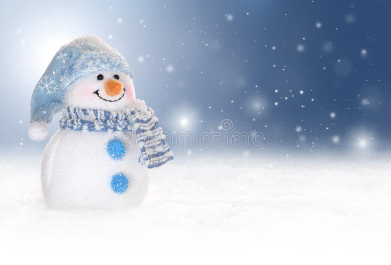 Χειμερινή ανασκόπηση με έναν χιονάνθρωπο, ένα χιόνι και snowflakes στοκ φωτογραφία