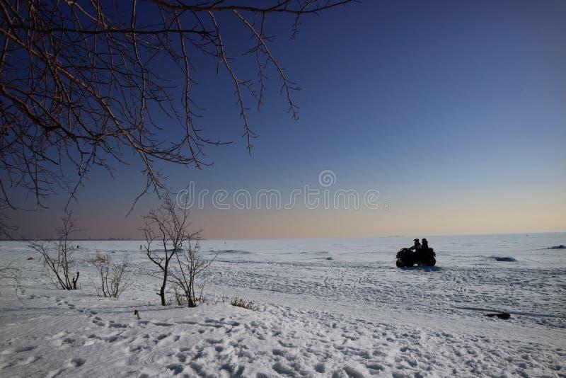 Χειμερινό ταξίδι στο ATV στοκ εικόνα