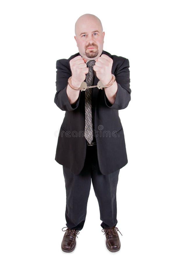χειροπέδες επιχειρηματ& στοκ εικόνα