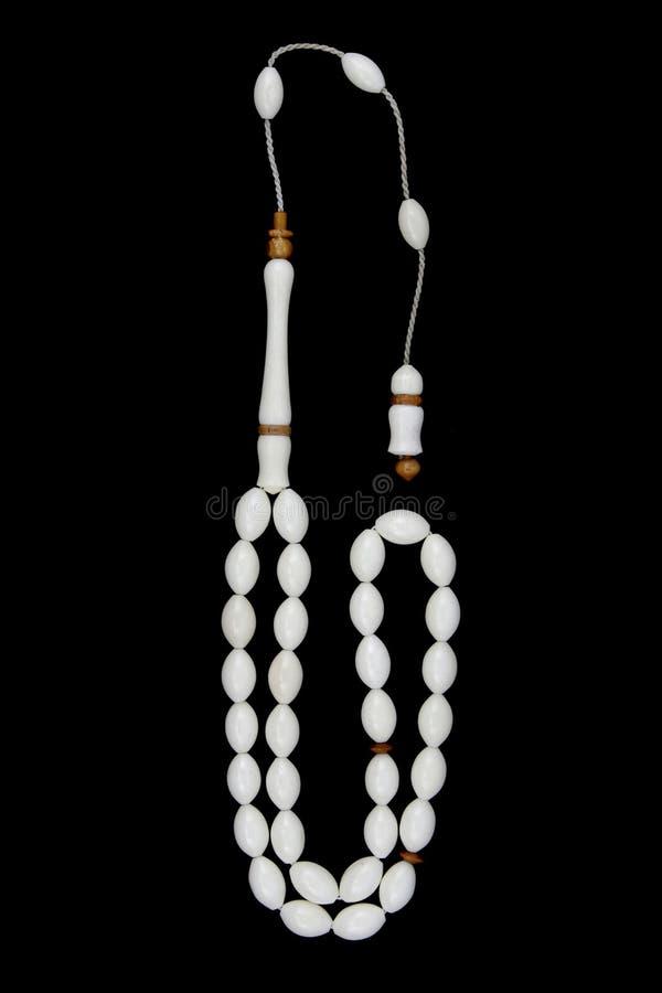 Χειροποίητες rosary κόκκαλων καμηλών χάντρες προσευχής που απομονώνονται στο Μαύρο στοκ φωτογραφία