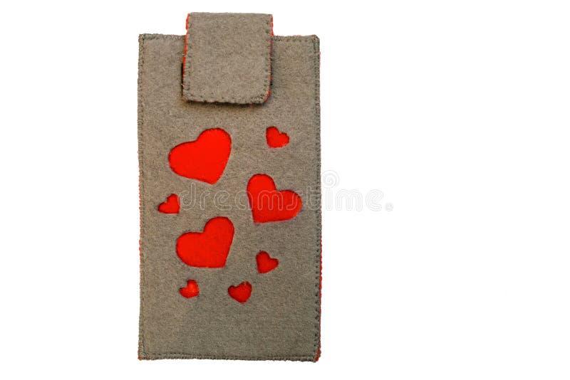 Χειροποίητη τηλεφωνική περίπτωση φιαγμένη από αισθητός με τις κόκκινες καρδιές στοκ φωτογραφία με δικαίωμα ελεύθερης χρήσης