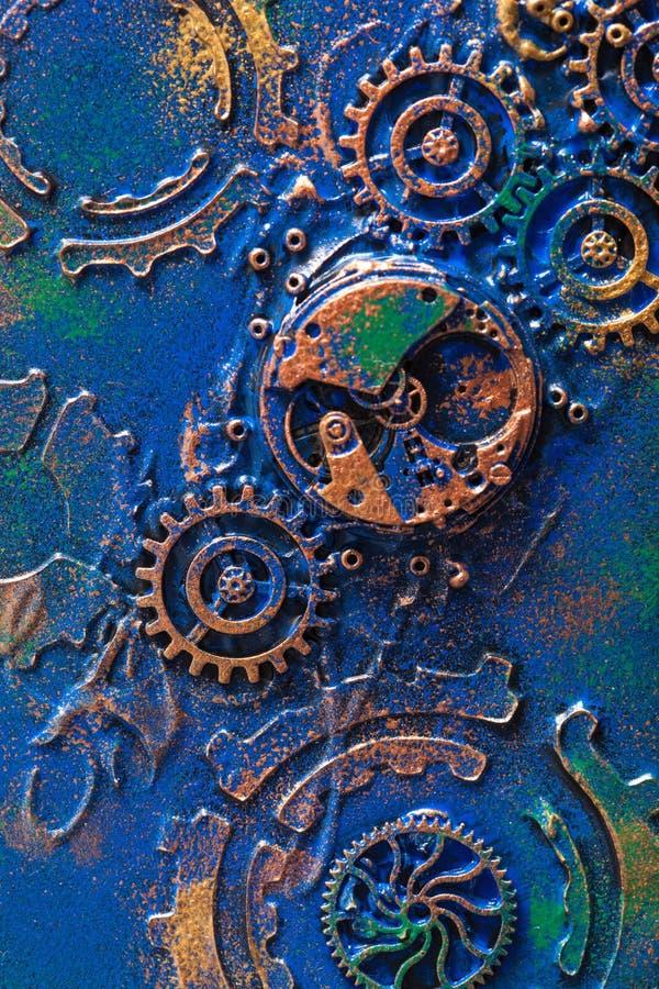 Χειροποίητος steampunk μηχανισμός ροδών βαραίνω υποβάθρου μηχανικός στοκ εικόνα