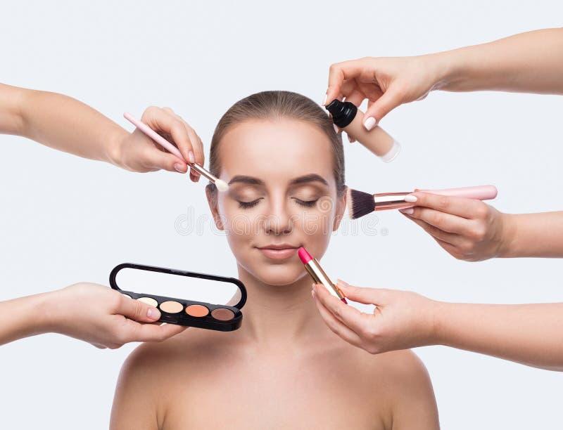 Χεριών makeup που απομονώνεται να κάνει πολλών στο λευκό στοκ εικόνα