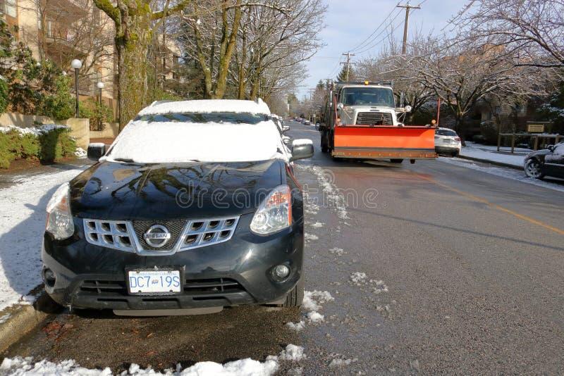 Χιονοπτώσεις του Βανκούβερ και άροτρο χιονιού στοκ φωτογραφία