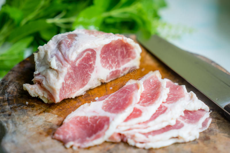 χοιρινό κρέας που τεμαχίζ&eps στοκ εικόνα με δικαίωμα ελεύθερης χρήσης