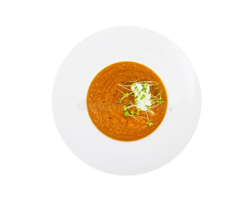 Χορτοφάγος πουρές σούπας κολοκύθας με τα πράσινα σαλάτας κάρδαμου στοκ φωτογραφίες