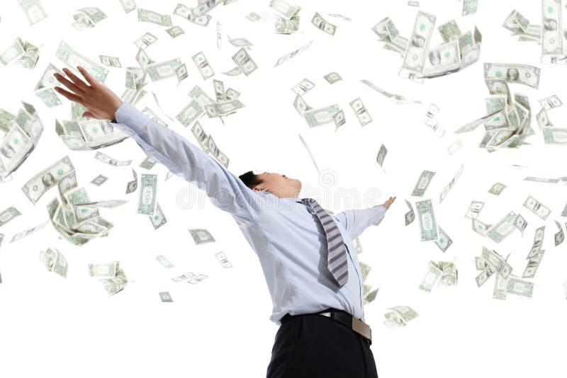 Χρήματα αγκαλιάσματος επιχειρησιακών ατόμων στοκ εικόνες
