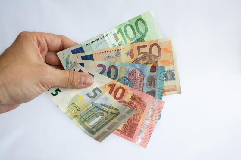 Χρήματα εκμετάλλευσης ατόμων στα χέρια του στοκ εικόνες