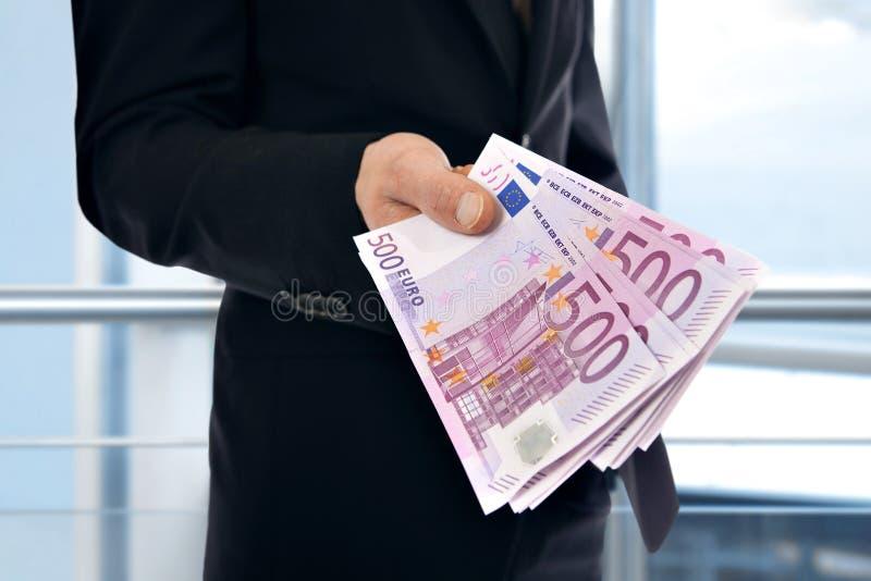 Χρήματα εκμετάλλευσης επιχειρηματιών - ευρώ στοκ εικόνα με δικαίωμα ελεύθερης χρήσης