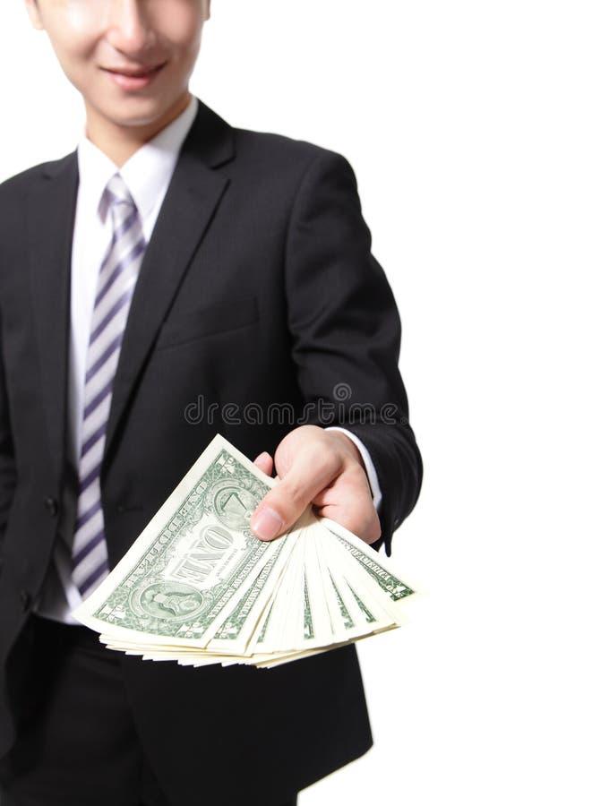 Χρήματα εκμετάλλευσης χεριών επιχειρησιακών ατόμων στοκ εικόνες